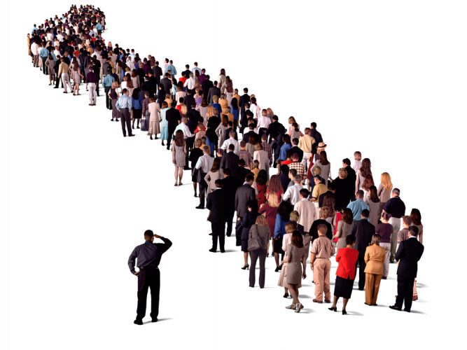 Photo of many people standing in a long queue