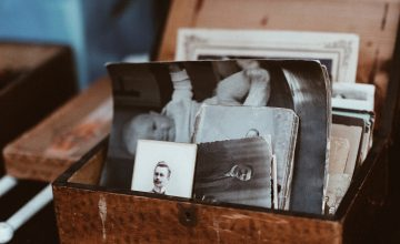 Photo of some old family photos sitting in a much-loved chest